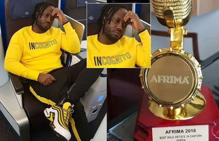 Bebe Col showing off his AFRIMA 2018 award