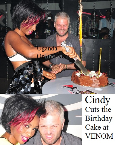 Cindy cutting the birthday cake at Club Venom on Aug 28, 2013