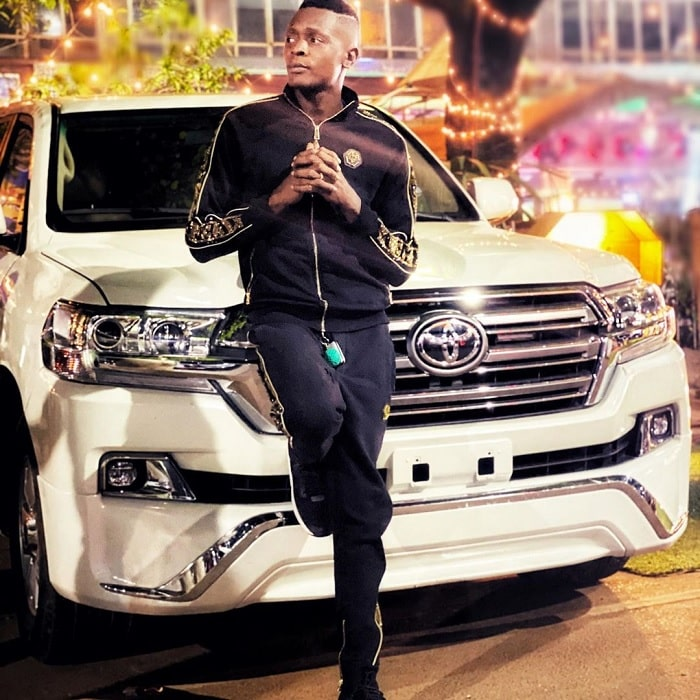Chameleone next to his ride...