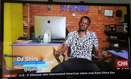 DJ Shiru while being interviewed by CNN at his office