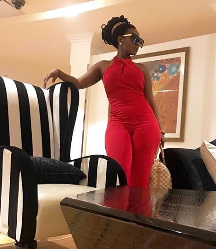 Desire Luzinda rocking a red jumpsuit