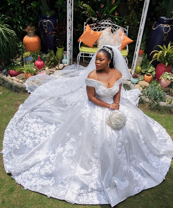 Esther Channelle shows off her wedding gown
