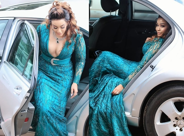 Zari pulls out of a Silver Merc on arrival at Rubaga Cathedral
