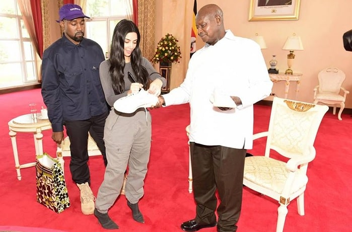 Kim Kardashian autographs the white Yeezy sneakers that they gifted President Museveni
