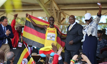 Photo moment - Kiplimo takes a shot with Uganda's President