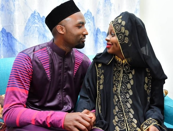 Hamzah and Rema look each other in the eye after the Nikah wedding
