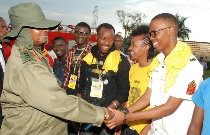 President Museveni shaking hands with Big Eye