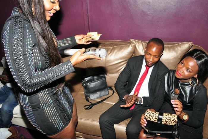 Desire Luzinda after receiving some cash from the Luzzi's