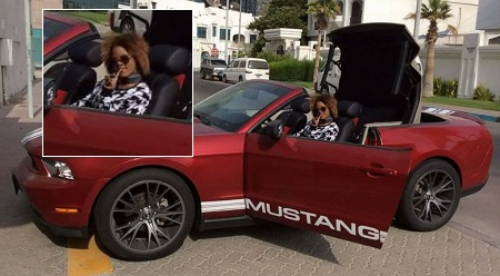 Suzana in her Ford Mustang