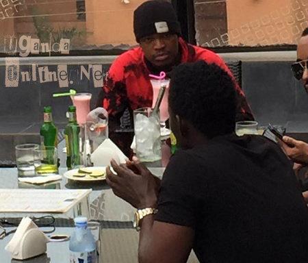 Neyo listens to Maurice Kirya