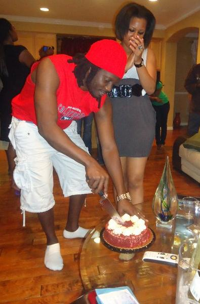 Bebe Cool Cuts a cake during his surprise party