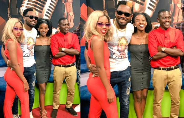 Sheila Gashumba in a red jumpsuit strikes a pose with Kranium