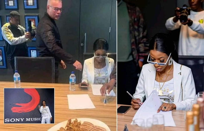 Vinka putting pen on paper on the Sony Music Entertainment contract