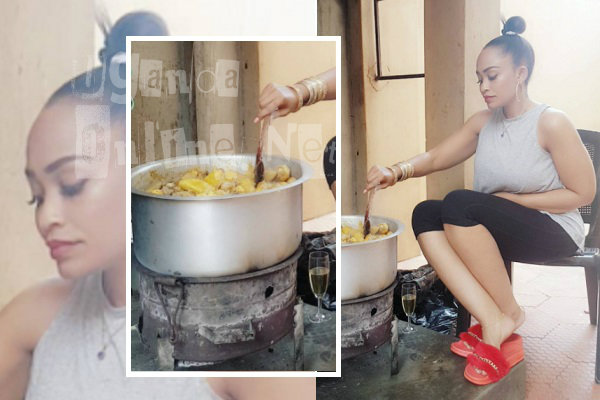 Zari cooking food with a glass of champagne on the side