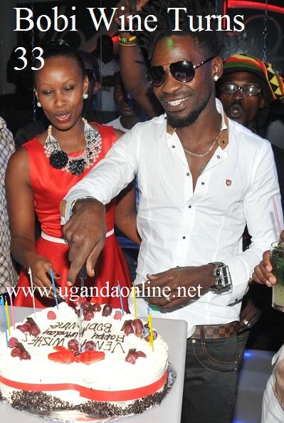 Bobi Wine and Barbie cutting the birthday cake