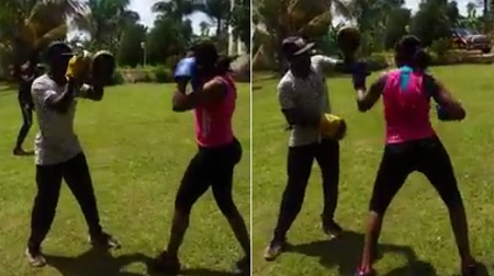 Barbie tries out boxing with her trainer, she is good