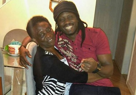 Bebe Cool and his mom in the US