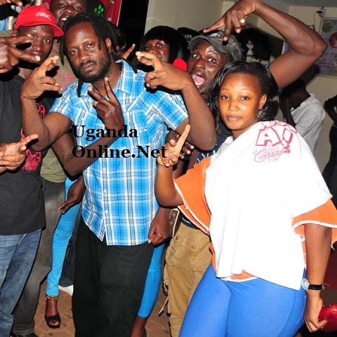 Bebe Cool posing with some of the Galaxy FM presenters