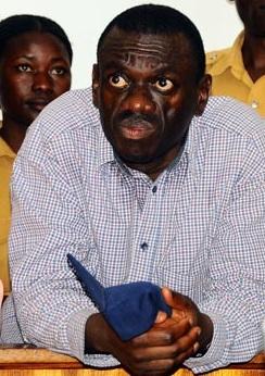 FDC Boss Kizza Besigye listens to the court proceedings