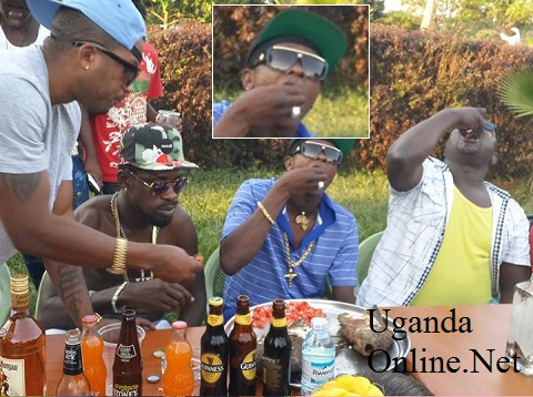 Meddie explains to Bobi as Chameleone forces the fish down his throat