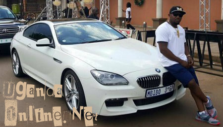 Mbibo strikes a pose on the BMW he sold twice