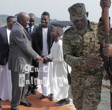 Bobi Wine's son Solomon shaking hands with the Kabaka at a recent function