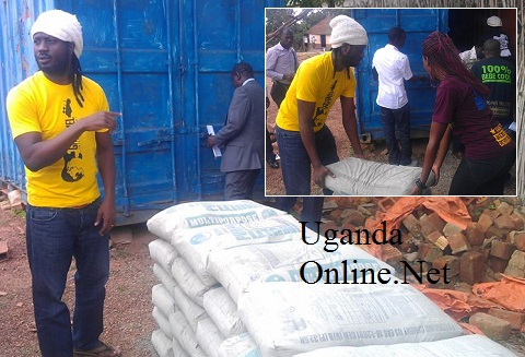 Bebe Cool Handing Over the bags of cement