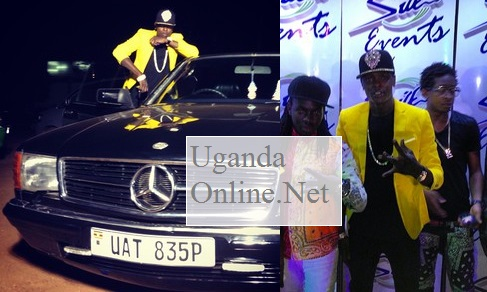 Chameleone next to his vintage car that he has just acquired