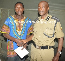 Jose Chameleone with the Inspector General of Police after his passport had been retained in Tanzania last year