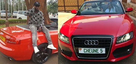 Cheune strikes a pose on his red AUDI
