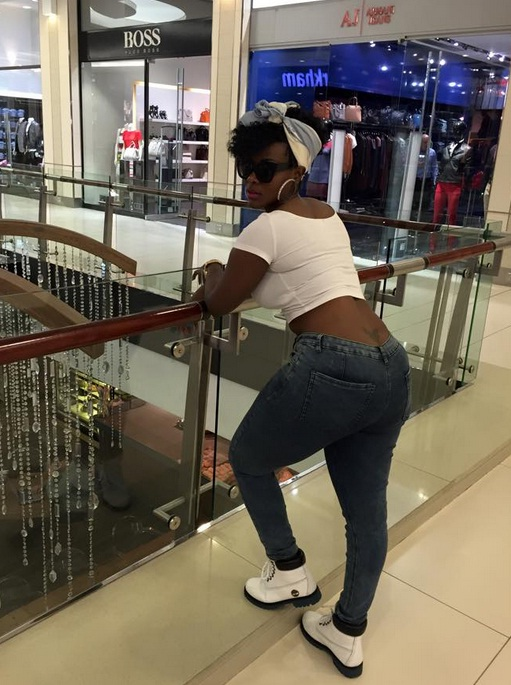 Desire Luzinda showing off her back tattoo
