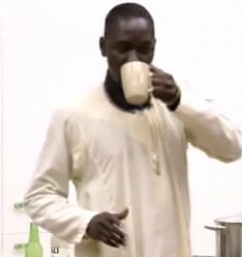 Ernest taking his last cup of coffee in the Big Brother house
