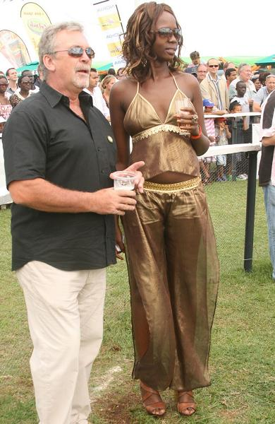 A couple at the RoyalAscot Goat Races in Munyonyo on the September 18