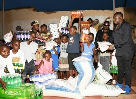Ivan Semwanga donating to kids in Nsambya