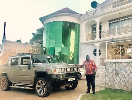 Ivan Semwanga next to his Hummer pick-up