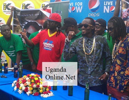 Bebe Cool (red), Moze Radio and Weasel at the press conference ahead of the Battle of the Champions