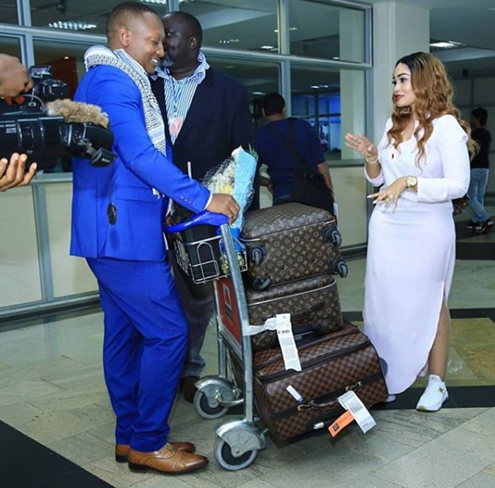 JK Kazoora and Johnnie Sempebwa receing Zari at the Entebbe International Airport