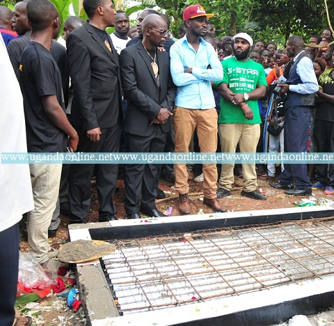 Roger Mugisha and Bobi Wine (Red Top) comfort Amon