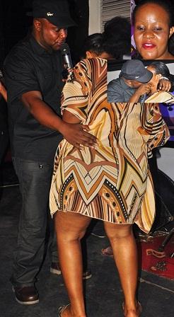 Kidum butt feeling n kissing  a fan at Club Rouge