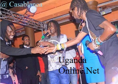 Moze Radio shaking hands with Bebe Cool in 2014