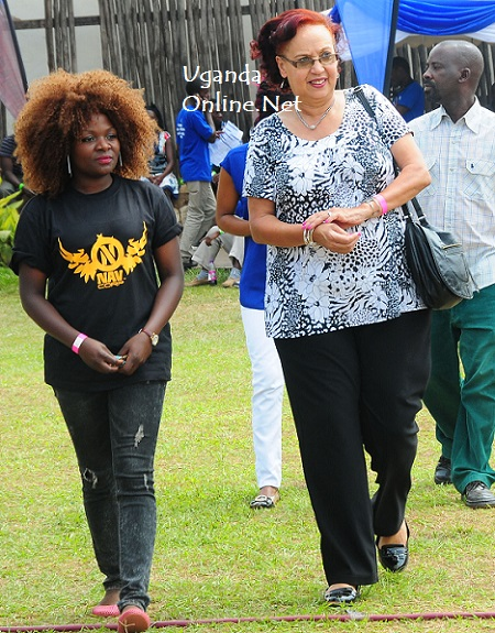 Navio's Mom, Prof. Maggie Kigozi being led to the VIP section