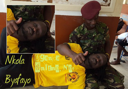 UPDF soldier working n Bebe Cool's locs