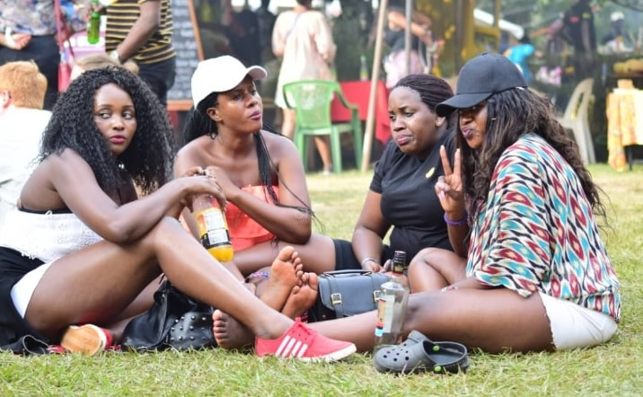 Babes armed with a bottle of Uganda Waragi