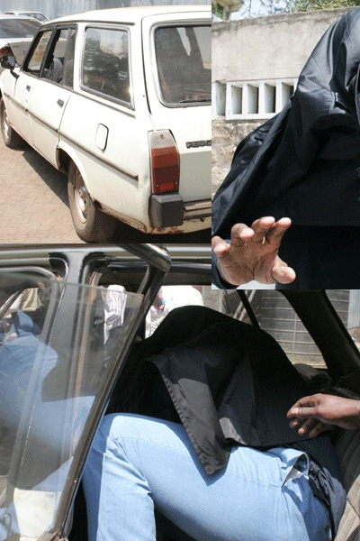 Mike Ezra hiding from the press at the Kenyan court on February 17