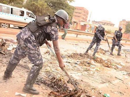 Policemen trying to clear the mess on the Entebbe-Kampala highway