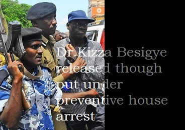 Kampala Metropolitan police boss Andrew Kaweesi holding Dr.Kizza Besigye after the arrest