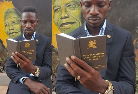 Bobi Wine reading the rules of procedure of the Parliament of Uganda
