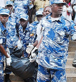 Police carrying the remains of Juliet Nalujja