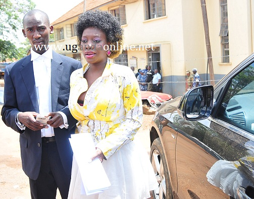 Bad Black and her lawyer at Kiira Road Police Station