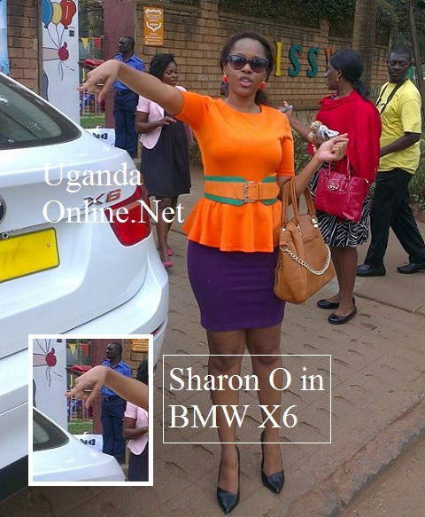 Sharon O pointing at the white luxury SUV
